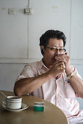 61 year old Lay Kee Tee, a former pig farmer and a  survivor of the Nipah virus seen at a Chinese cafe in Bukit Pelandok in Nageri Sembilan, Malaysia on October 16th, 2016. <br /> In September 1998, a virus among pig farmers (associated with a high mortality rate) was first reported in the state of Perak in Malaysia. Dr. Chua investigated and discovered the virus and it was later named, Nipah Virus. The outbreak in Malaysia was controlled through the culling of &gt;1 million pigs.
