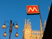 Metro entrance sign and the Duomo, Milan, Ital