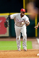 Philadelphia Phillies first baseman Ryan Howard #6 tosses the ball to the pitcher during the Major League Baseball game against the Houston Astros at Minute Maid Park in Houston, Texas on September 13, 2011. Houston defeated Philadelphia 5-2.  (Andrew Woolley/Four Seam Images)