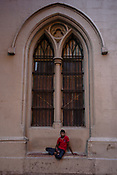 A man is seen sitting outside the Calcutta High Court in BBD Bagh in Kolkata, West Bengal  on Thursday, May 25, 2017. Photographer: Sanjit Das