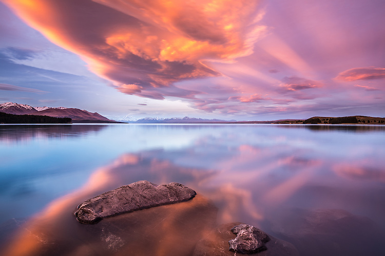 Lenticular clouds at sunset over Lake Puakaki, Mackenzie Country, New Zealand