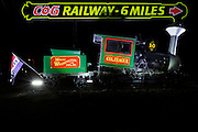 Mount Washington Cog Railway 6 miles sign at Fabyan's Station from Base Road in Bretton Woods, New Hampshire USA during the night.