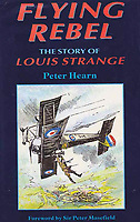 BNPS.,co.uk (01202 558833)<br /> Pic: DorsetLife/BNPS<br /> <br /> The flying exploits of Strange were recalled in print.<br /> <br /> A war hero who was dubbed the 'bravest man in the world' has been remembered after his lost and abandoned grave was re-discovered.<br /> <br /> The family of Lieutenant Colonel Louis Strange held a moving ceremony in a churchyard after his grave was repaired, spruced-up and re-dedicated. <br /> <br /> Lt Col Strange was a highly-decorated aviator pioneer who served in both world wars and cheated death on two occasions 25 years apart.<br /> <br /> He was buried in a village churchyard in Worth Matravers, Dorset, with a simple gravestone that was found leaning over and covered in lichen.