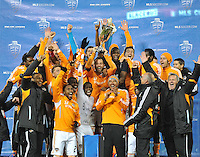 Houston Dynamo captain Brad Davis lifts the Eastern Conference Trophy. D.C. United tied The Houston Dynamo 1-1 but lost in the overall score 4-2 in the second leg of the Eastern Conference Championship at RFK Stadium, Sunday November 18, 2012.