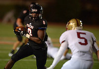 Sep 20, 2013; Los Angeles, CA, USA; Occidental College Tigers running back Kwame Do (3) carries the ball against the Austin College Kangaroos at Patterson Field. Photo by Kirby Lee