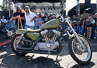 NWA Democrat-Gazette/BEN GOFF @NWABENGOFF<br /> Scotty 'Memphis' Robertson (left) and Matt Gillen of Steele, Mo. stand with their 'Jarhead' U.S. Marine Corps-inspired bike on Saturday Sept. 26, 2015 during the Stokes Air Battle of the Bikes at the annual Bikes, Blues & BBQ motorcycle rally in downtown Fayetteville.