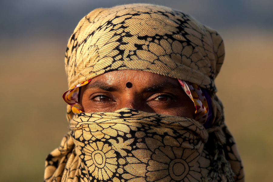 An agricultural worker is photographed in Indore, India.