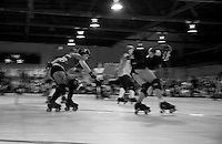 """Sassy Slayher"" of the SF ShEvil Dead chases ""Grr Lee Burly"" of the Oakland Outlaws during the Bay Area Derby Girls season opener in Oakland, CA. Both are jammers for the B.A.D. Girls' All-Stars Travel Team ranked #10 in the country...(©Matt McKnight, 2008)"