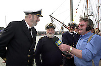 Radio Kerry's Ted Creedon, who is travelling on the vopyage,  interviews Captain Mike Forewood and John Gill at the naming ceremony of the Jeanie Johnston on Sunday..Picture by Don MacMonagle