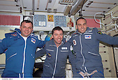 "The Soyuz Taxi crewmembers pose for a group photo in the Zvezda Service Module on the International Space Station (ISS).   From the left are Commander Yuri Gidzenko, who was a member of the first resident crew of the ISS; Flight Engineer Roberto Vittori of the European Space Agency (ESA); and South African space flight participant Mark Shuttleworth. The ""taxi"" crew arrived at the orbital outpost on April 27, 2002 at 2:56 a.m. (CDT) as the two vehicles flew over Central Asia.<br /> Credit: NASA via CNP<br />                                                                     Gidzenko represents Rosaviakosmos."