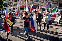 Roma 3 Ottobre 2015<br /> Manifestazione a sostegno del Presidente russo Putin, a  Piazzale Flaminio,  &ldquo;Io sto con Putin&quot; , per sconfiggere il terrorismo islamico, per fermare la crisi migratoria, per ritrovare la sovranit&agrave;&rdquo;. I manifestanti chiedono anche l&rsquo;immediata rimozione delle sanzioni alla Russia. La manifestazione &egrave; organizzata dal Comitato Italia-Russia e dal Vladimir Putin Italian Fan Club. Manifestanti pro Putin allontanano una donna ucraina con la bandiera rossa e nera che era stata utilizzata dai collaborazionisti ucraini con la  Germania nazista.<br /> Rome, October 3, 2015<br /> Rally in support of Russian President Putin, Piazzale Flaminio, &quot;I'm with Putin&quot;, to defeat Islamic terrorism, to stop the migration crisis, to regain sovereignty.The protesters are also demanding the immediate removal of sanctions on Russia.The event is organized by the committee Italy-Russia,  and  from Vladimir Putin the Italian Fan Club. Demonstrators pro Putin hunt a Ukrainian woman with red and black flag, that was used by Ukrainian collaborators with Nazi Germany.