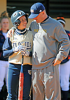 Florida International University Head Coach Jake Schumann and infielder Jessy Alfonso (8) during the game against the University of Illinois.  FIU won the game 8-0 on February 12, 2012 at Miami, Florida. .