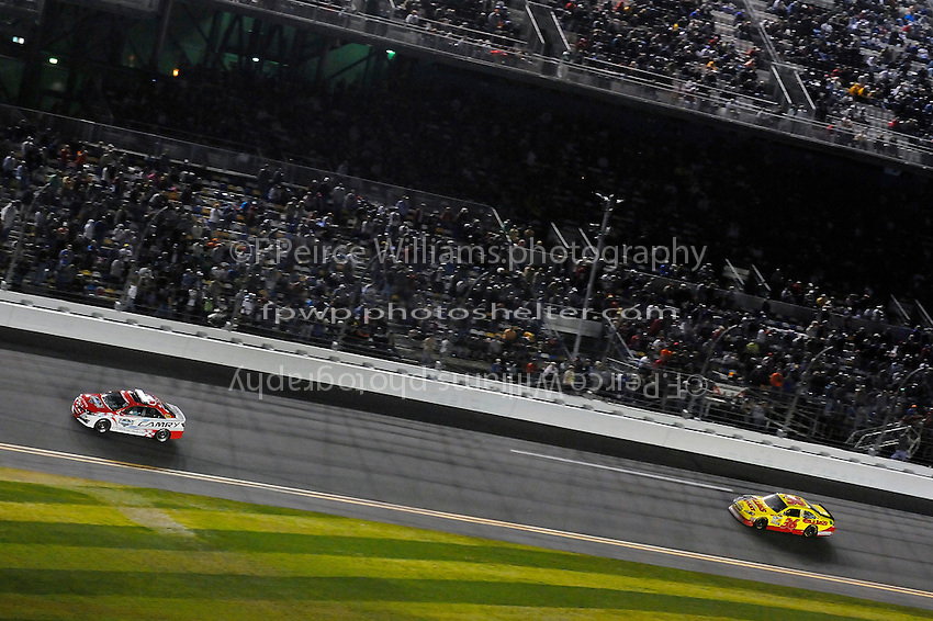 Dave Blaney (#36) leads the field as the race is about to be re-started after the fire in turn 3.