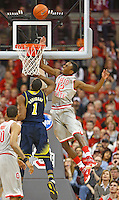 Ohio State Buckeyes forward Sam Thompson (12) blocks a shot by Michigan Wolverines forward Glenn Robinson III (1) in first half action at Nationwide Arena on February 11,  2014. (Chris Russell/Dispatch Photo)