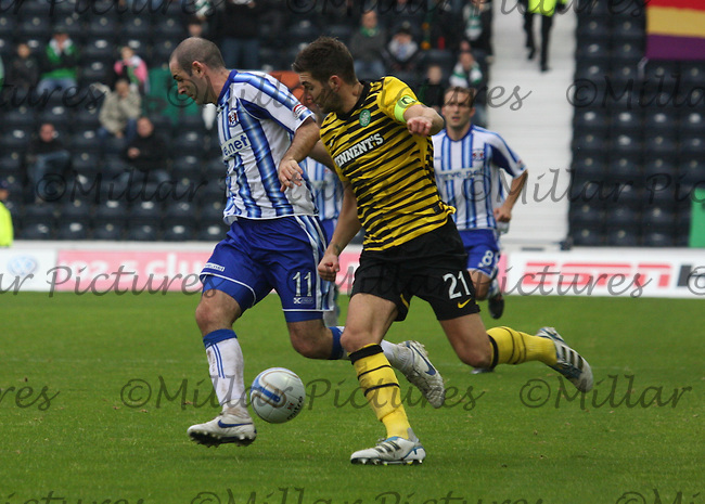 Gary Harkins shielding the ball from Charlie Mulgrew in the Kilmarnock v Celtic Clydesdale Bank Scottish Premier League match played at Rugby Park, Kilmarnock on 1.10.11