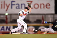 Nashville Sounds second baseman Pete Orr (11) swipes the throw as Brian Fletcher (6) slides in during a game against the Omaha Storm Chasers on May 19, 2014 at Herschel Greer Stadium in Nashville, Tennessee.  Nashville defeated Omaha 5-4.  (Mike Janes/Four Seam Images)