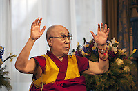 "Switzerland. Basel. His Holiness the Dalai Lama during a press conference at Grand Hotel Les Trois Rois. Hands up. The 14th and current Dalai Lama is Tenzin Gyatso, recognized since 1950. He is the current Dalai Lama, as well as the longest-lived incumbent, well known for his lifelong advocacy for Tibetans inside and outside Tibet. Dalai Lamas are amongst the head monks of the Gelug school, the newest of the schools of Tibetan Buddhism. The Dalai Lama, also called "" Ocean of Wisdom"" is considered as the incarnation of Chenresi, the Bodhisattva of compassion who is also the protective deity of Tibet. 7.02.2015 © 2015 Didier Ruef"