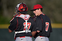 Illinois State Redbirds relief pitcher Marcus McKinney (17) talks with catcher Jean Ramirez (27) during a game against the Indiana Hoosiers on March 4, 2016 at North Charlotte Regional Park in Port Charlotte, Florida.  Indiana defeated Illinois State 14-1.  (Mike Janes/Four Seam Images)