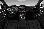 Stock photo of straight dashboard view of 2017 BMW 3-Series 330i-Gran-Turismo 5 Door Hatchback Dashboard