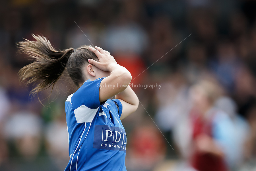 Daniela GUDELJ of South Melbourne reacts after missing a kick on goal. Action in the grand final of the 2013 Women's Premier League at the Veneto Club, Bulleen. Photo Sydney Low.