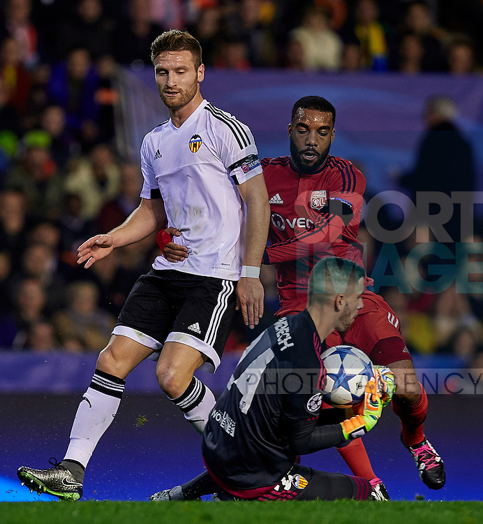 Jaume Domenech (C) goalkeeper of Valencia CF catches the ball between Skodran Mustafi (L)  of Valencia CF and Alexandre Lacazette of Olympique Lyonnais - UEFA Champions League Group H - Valencia CF vs Olympique Lyonnais - Mestalla Stadium - Valencia- Spain - 09th December 2015 - Pic David Aliaga/Sportimage