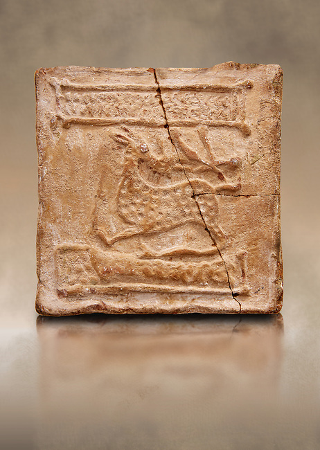 6th-7th Century Eastern Roman Byzantine  Christian Terracotta tiles depicting a stag - Produced in Byzacena -  present day Tunisia. <br /> <br /> The stag is a traditional Christian symbol for Christ, Who tramples and destroys the Devil. In the Medieval bestiaries the stag as an enemy of snakes. It was believed that stags was believed to chase snakes into their holes or rock crevices, driving them out by flooding the hole with the breath or water from its mouth, and eating them. <br /> <br /> These early Christian terracotta tiles were mass produced thanks to moulds. Their quadrangular, square or rectangular shape as well as the standardised sizes in use in the different regions were determined by their architectonic function and were designed to facilitate their assembly according to various combinations to decorate large flat surfaces of walls or ceilings. <br /> <br /> Byzacena stood out for its use of biblical and hagiographic themes and a richer variety of animals, birds and roses. Some deer and lions were obviously inspired from Zeugitana prototypes attesting to the pre-existence of this province's production with respect to that of Byzacena. The rules governing this art are similar to those that applied to late Roman and Christian art with, in the case of Byzacena, an obvious popular connotation. Its distinguishing features are flatness, a predilection for symmetrical compositions, frontal and lateral representations, the absence of tridimensional attitudes and the naivety of some details (large eyes, pointed chins). Mass production enabled this type of decoration to be widely used at little cost and it played a role as ideograms and for teaching catechism through pictures. Painting, now often faded, enhanced motifs in relief or enriched them with additional details to break their repetitive monotony.<br /> <br /> The Bardo National Museum Tunis, Tunisia