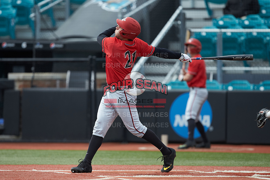 Brian Leonhardt (21) of the San Diego State Aztecs follows through on his swing against the UNCG Spartans at Springs Brooks Stadium on February 16, 2020 in Conway, South Carolina. The Spartans defeated the Aztecs 11-4.  (Brian Westerholt/Four Seam Images)