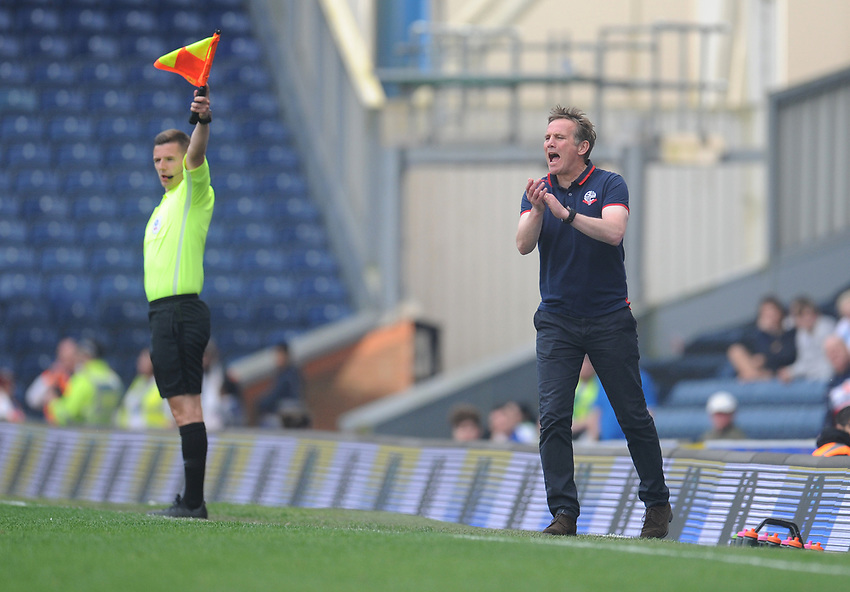 Bolton Wanderers manager Phil Parkinson shouts instructions to his team from the dug-out <br /> <br /> Photographer Kevin Barnes/CameraSport<br /> <br /> The EFL Sky Bet Championship - Blackburn Rovers v Bolton Wanderers - Monday 22nd April 2019 - Ewood Park - Blackburn<br /> <br /> World Copyright © 2019 CameraSport. All rights reserved. 43 Linden Ave. Countesthorpe. Leicester. England. LE8 5PG - Tel: +44 (0) 116 277 4147 - admin@camerasport.com - www.camerasport.com