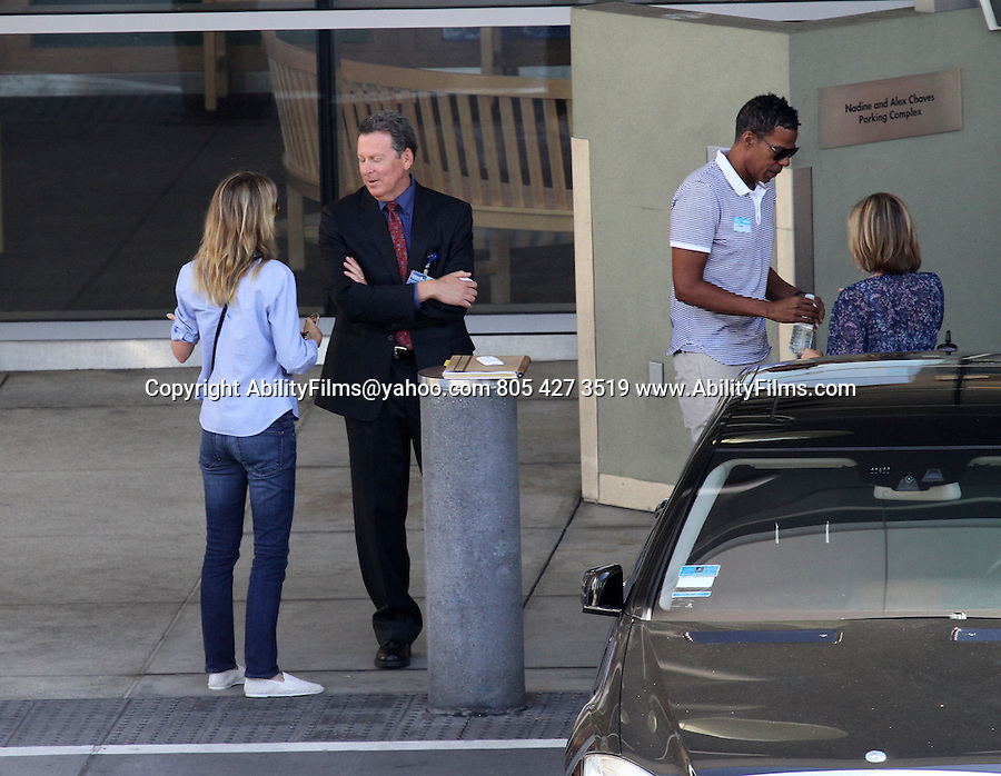 June 29th   2012  Friday <br /> <br /> Ellen Pompeo &amp; her husband Chris Ivery stopped by the Childrens Hospital in Los Angeles for a few hours to visit with the children. Chris had to get some money from Ellen to pay for the valet parking.  They both had to wear a name tag when visiting the hospital &amp; hugged and laughed and talked with the workers before leaving. <br /> <br /> AbilityFilms@yahoo.com<br /> 805 427 3519<br /> www.AbilityFilms.com