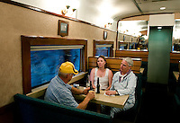 Tourists on the Express  train on a trip through Barranca del Cobre (Copper Canyon) using the last passenger train in Mexico passes through a tunnel, Saturday, June 21, 2008. The Express train offers a restaurant with drinks and food as well as nicer seating...PHOTOS/ MATT NAGER