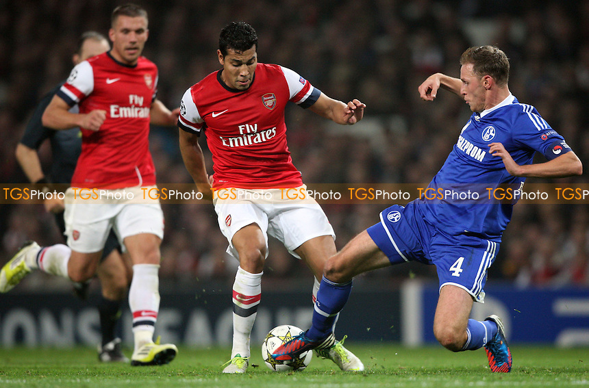 Andre Santos of Arsenal is challenged by Benedikt Howedes of Schalke - Arsenal vs FC Schalke 04, Champions League Group B at The Emirates Stadium, Arsenal - 24/10/12 - MANDATORY CREDIT: Rob Newell/TGSPHOTO - Self billing applies where appropriate - 0845 094 6026 - contact@tgsphoto.co.uk - NO UNPAID USE.