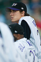 Louisville Bats pitcher Homer Bailey (22) watches the action from the top step of the dugout at Louisville Slugger Field in Louisville, KY, Tuesday, June 5, 2007.