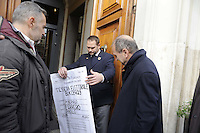 Roma, 23 Novembre 2011.Ambasciata di Germania.Presidio e conferenza stampa, per chiedere alla Germania di diventare ufficialmente elettori tedeschi organizzata dal Partito di Rifondazione comunista. Paolo Ferrero consegna una gigantografia della sua tessera elettorale