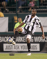 Rochester Rhinos defender Quavas Kirk (13) traps the ball. In a Third Round U.S. Open Cup match, the Chicago Fire defeated the Rochester Rhinos, 1-0, at Sahlens Stadium on June 28, 2011.