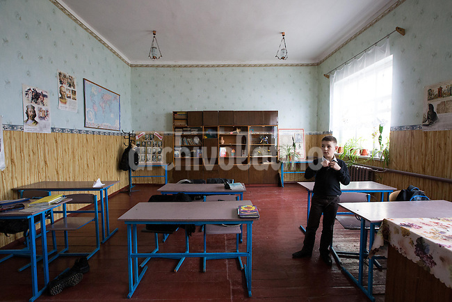 A pupil in a schoold of the town of  Veliki Solonzi, in Poltava region, eastern Ukraine. Most kids deserted the schoold and the region when pro  Russian groups tried to seize control of the place.