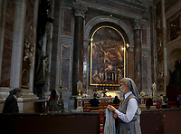 Nun visits St. Peter's Basilica on May 18, 2020 at the Vatican in the day of its reopening. Italy is slowly lifting sanitary restrictions after a two-month coronavirus lockdown.<br /> UPDATE IMAGES PRESS/Isabella Bonotto<br /> <br /> STRICTLY ONLY FOR EDITORIAL USE