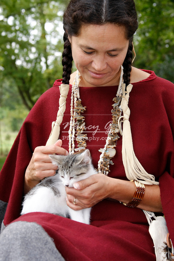Native American Indian Lakota Sioux woman petting a kitten