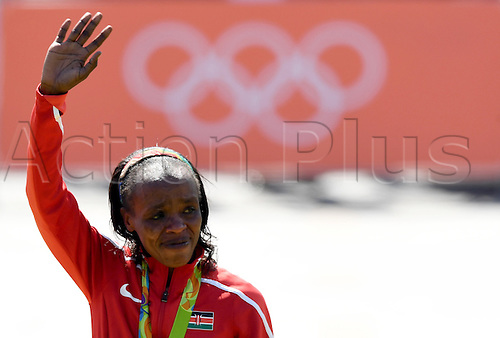 14.08.2016. Rio de Janeiro, Brazil. Gold medalist Jemima Jelagat Sumgong of Kenya celebrates during the medal ceremony of the Women's Marathon of the Athletic, Track and Field events during the Rio 2016 Olympic Games at Sambodromo in Rio de Janeiro, Brazil, 14 August 2016.