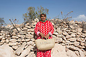 """Fatima Aamin, 36, from Idmine. A mother of two, Aamin has joined the cooperative in 2010 and has been able to gain around 60 euros per month since then. Although Aamin spends only half a day at Ajddigue, the woman feels empowered by having her own revenue. """"When I was producing oil at home, it was my husband who sold it at the market and kept all the money"""" she explain. """"But now, thanks to this work, local women feel they can stand up to their husbands."""""""