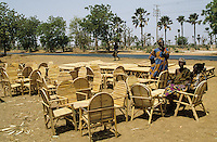 Farmer selling forniture made from Borassus aethiopum palmtree