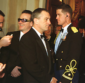 Robert De Niro waits in the receiving line at the Millennium Celebration at the White House in Washington, D.C. on December 31, 1999. Bono waits in line behind him at left..Credit: Ron Sachs / CNP