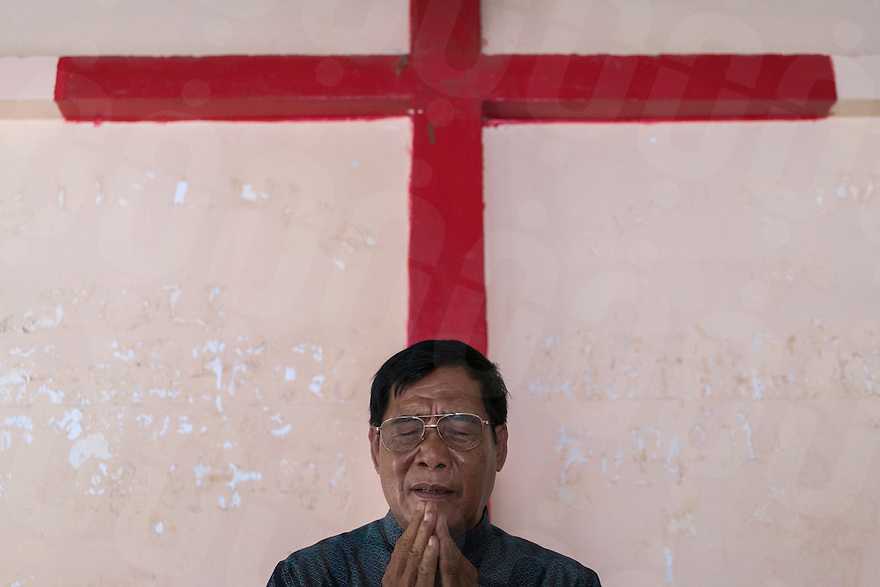 "December 4, 2016 - Kampong Speu (Cambodia). Ing Sophat celebrates the Sunday's service at the ""Khum O"" presbyterian church. Ing was a former commander of a Khmer Rouge platoon under the control of Ta Mok - best known as ""Brother Number Five"" or ""the Butcher""- and he is now is a pastor in the small rural church of Phnom Srouch. © Thomas Cristofoletti / Ruom"