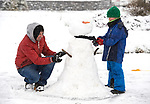 Tom and Odran Murphy making a snowman at Woodstock Hill in Ennis. Photograph by John Kelly.
