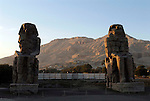 Colossi of Memnon, 60 foot high enthroned statues of the Pharaoh Amenhotep III (14th century BC) they stand on the flood plains on the West Bank of the River Nile at Thebes.The statue on the right, the East (or North) Colossus was damaged by an earthquake  'this statue emmitted strange sounds in the morning, perhaps due to the heat of the sun,or the humidity of the night.