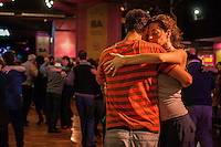 "Dancers dance the tango during a ""milonga"" on the 2013 World Tango Festival. A milonga is the place where people gather to dance tango, usually accompanied by live music."
