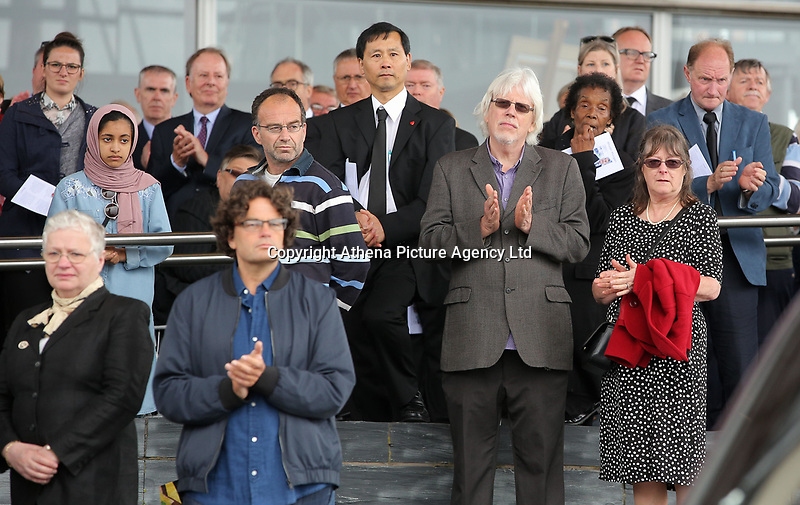 """Pictured: People attending applaud as his coffin is led away after the service. Wednesday 31 May 2017<br />Re: The funeral for former first minister Rhodri Morgan has taken place in the Senedd in Cardiff Bay.<br />The ceremony, which was open to the public, was conducted by humanist celebrant Lorraine Barrett.<br />She said the event was """"a celebration of his life through words, poetry and music"""".<br />Mr Morgan, who died earlier in May aged 77, served as the Welsh Assembly's first minister from 2000 to 2009.<br />He was credited with bringing stability to the fledgling assembly during his years in charge.<br />It is understood Mr Morgan had been out cycling near his home when he died."""
