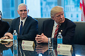 United States President-elect Donald Trump (R) and US Vice President-elect Mike Pence (L) are seen at a meeting of technology leaders in the Trump Organization conference room at Trump Tower in New York, NY, USA on December 14, 2016. <br /> Credit: Albin Lohr-Jones / Pool via CNP