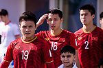 Nguyen Quang Hai of Vietnam (L) enters the pitch prior to the AFC Asian Cup UAE 2019 Group D match between Vietnam (VIE) and I.R. Iran (IRN) at Al Nahyan Stadium on 12 January 2019 in Abu Dhabi, United Arab Emirates. Photo by Marcio Rodrigo Machado / Power Sport Images