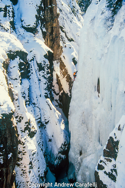 An ice climber ascends out  of Box Canyon near Ouray, Colorado.