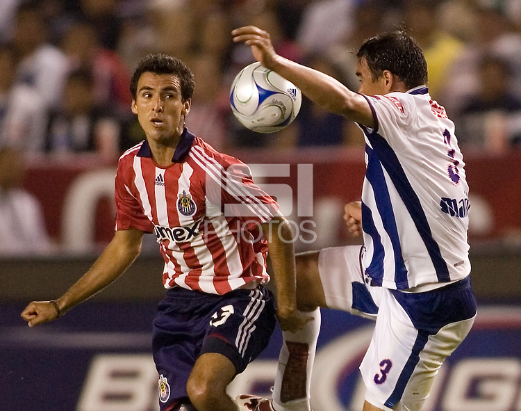 Chivas defender Jonathan Bornstein (13) battles Pachuca defender Julio Manzur (3 for a ball. Pachuca CF defeated the Chivas USA 2-1 during the 1st round of the 2008 SuperLiga at Home Depot Center stadium, in Carson, California on Sunday, July 13, 2008.